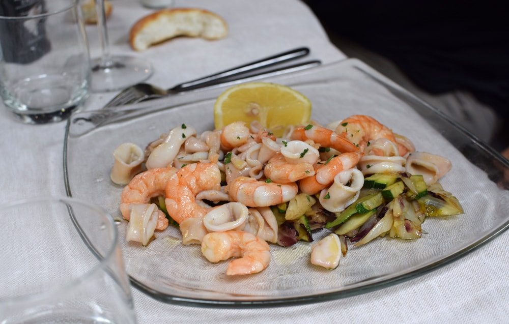 Delicious and gluten free seafood salad at Il Padellino restaurant in Turin