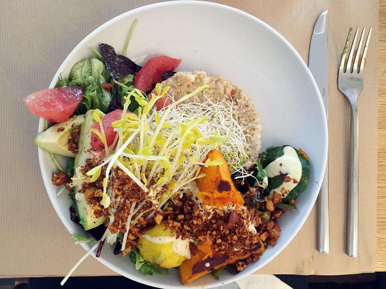 mix of quinoa, salad, pumpkin, avocado, grapefruit, tofu smoked almonds